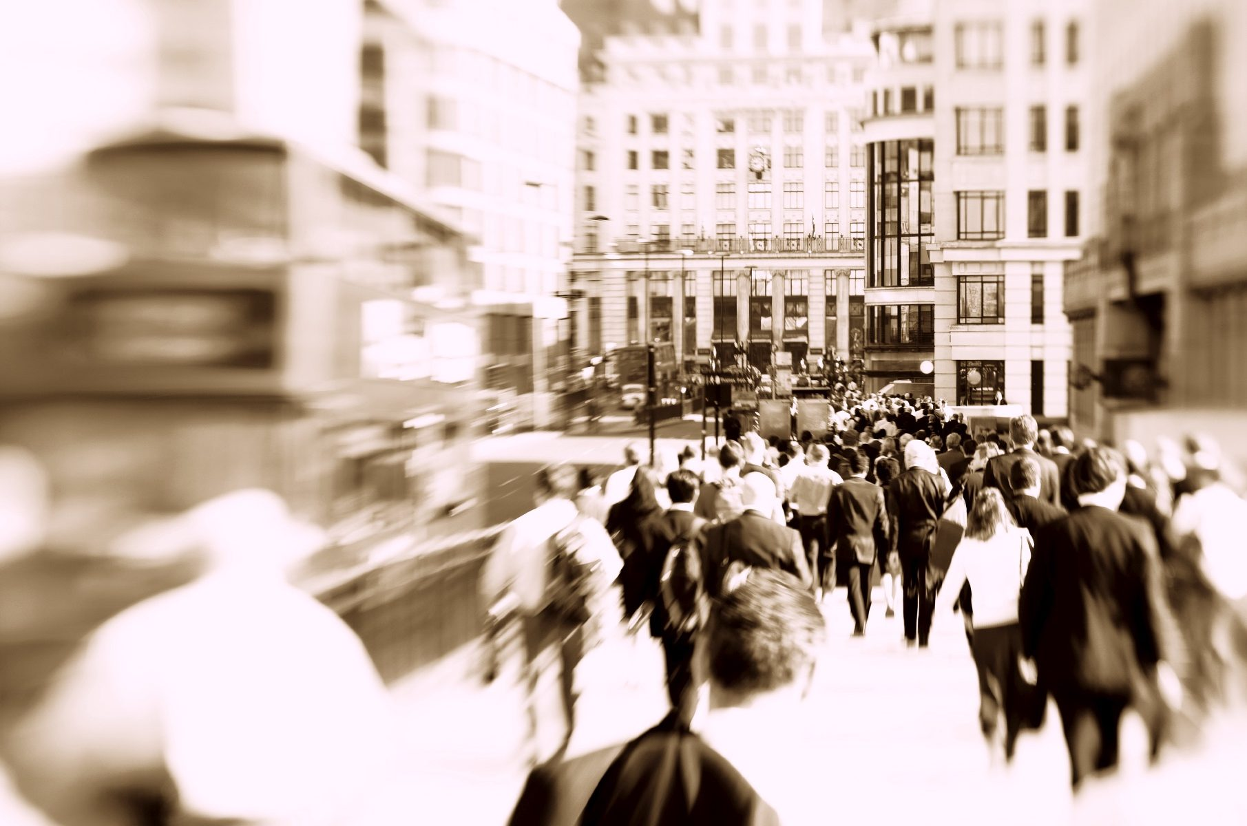 Blurred photograph of crowds walking through London