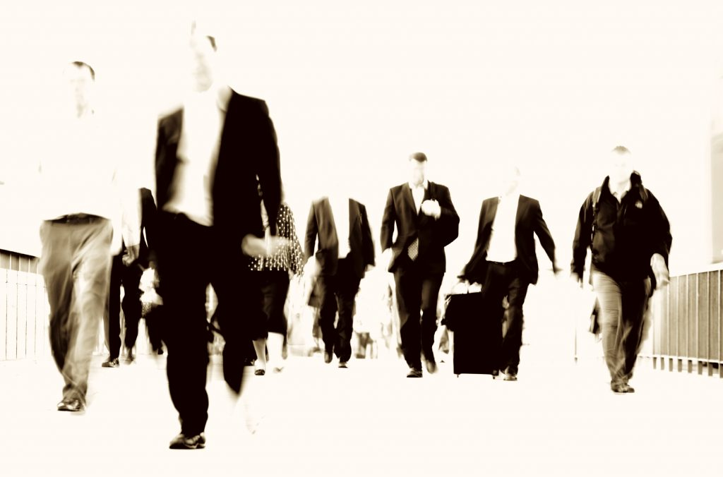 Businessmen walking across a bridge