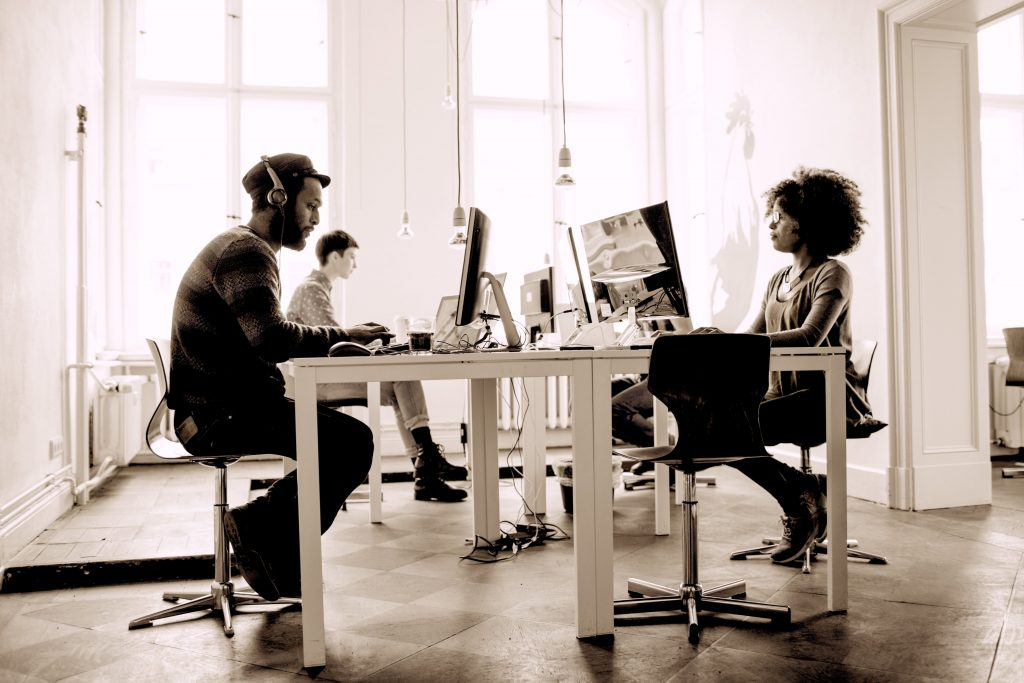 Young professionals working at desks in an office