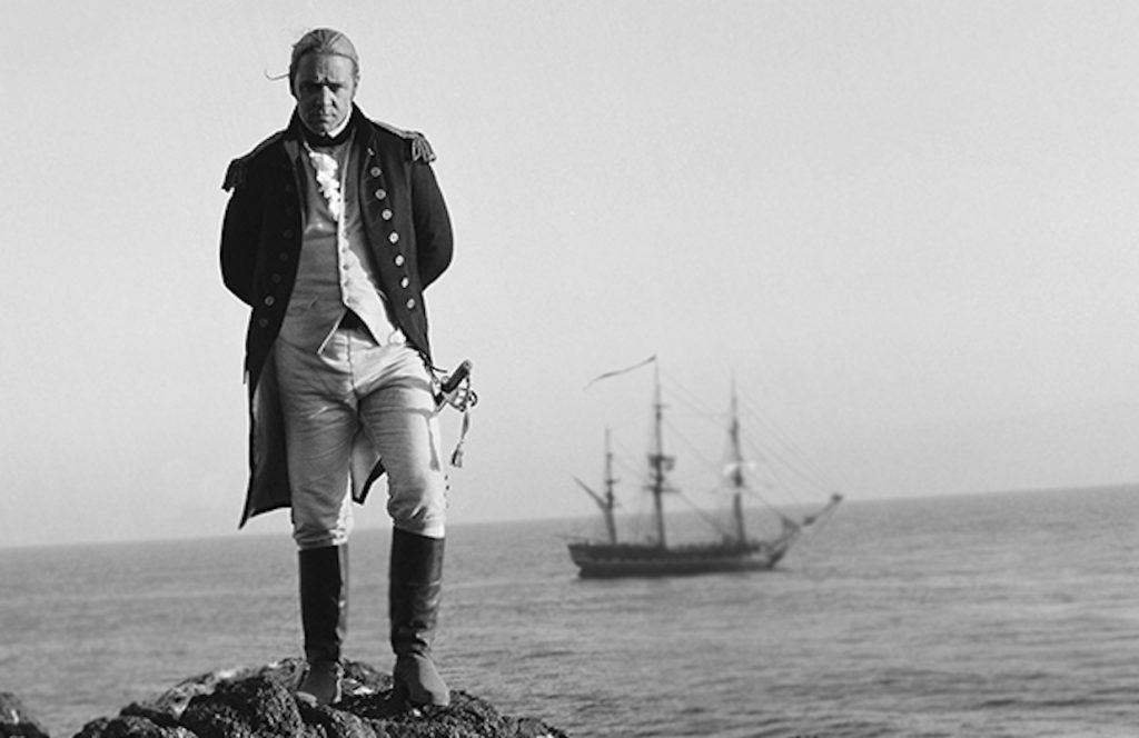 Film still from 'Master and Commander' showing a naval captain in front of his ship