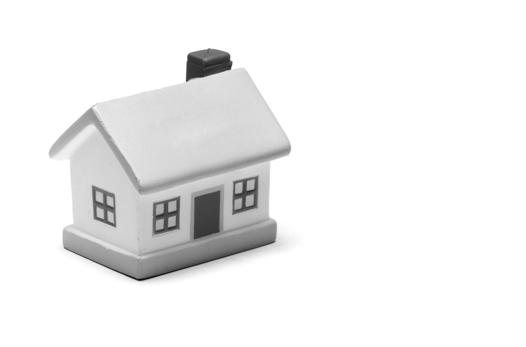 Miniature toy house on plain white background