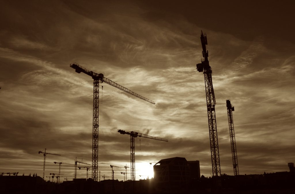 Cranes outlined against the sunset
