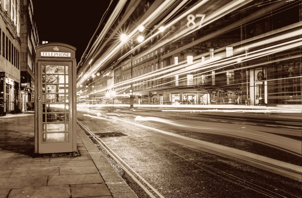 London street with phone box and bright lights