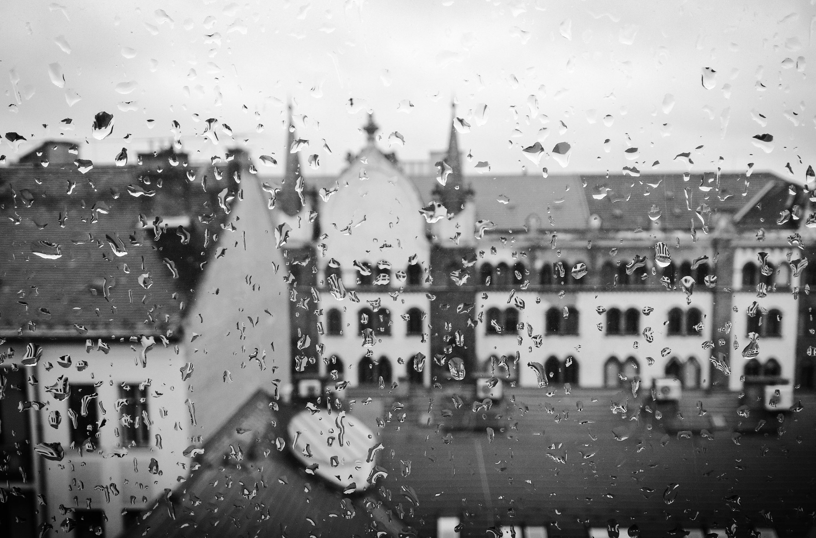 Rainy window looking out over city buildings
