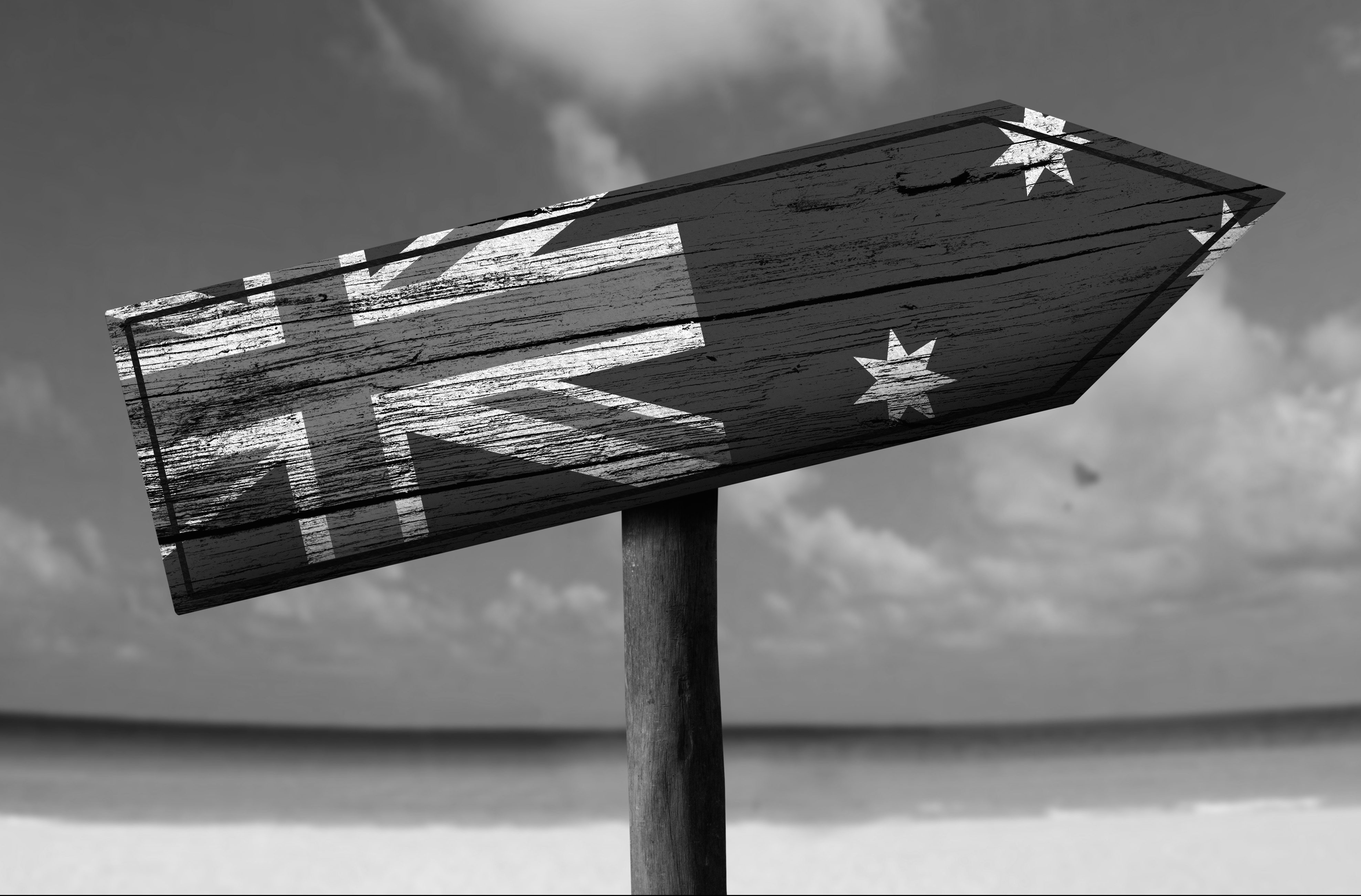 Sign showing Australian flag on a beach